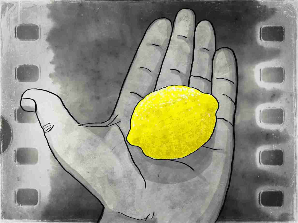 Corey-Holding-Lemon-In-Palm